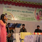 A local singer from Bagerhat sings in the fair where Venus improved cookstoves were shown.