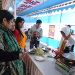 Jury board inspects cooking competition to decide the winners